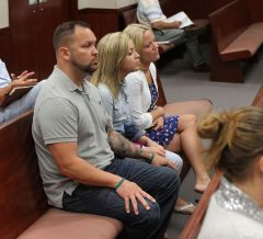 Stephen Hunt, Kaitlyn Hunt and Kelly Hunt Smith seated in the gallery of an Indian River County courtroom (Photo Credit, Keith Carson for Vero News)
